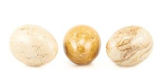 Three egg shaped stones Stock Photography