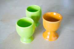 Three eggcups. On wooden background Stock Images