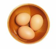 Three eggs. In cups isolated white background Royalty Free Stock Photos
