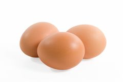 Three eggs. Isolated on a white background stock images