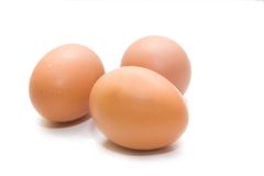 Three eggs. On the white isolated background Stock Images