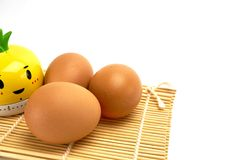 Three eggs on bamboo mat Royalty Free Stock Photo