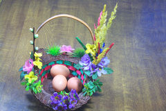 Easter : Three eggs in basket Royalty Free Stock Photography