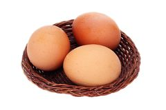 Three eggs in basket. Isolate Stock Photography