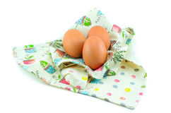 Three eggs on the beautiful cloth. Royalty Free Stock Photography