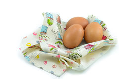 Three eggs on the beautiful cloth. Stock Photo