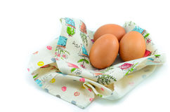 Three eggs on the beautiful cloth. Stock Photography