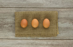 Three eggs on burlap Royalty Free Stock Photo