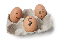 Three eggs in carton with a dollar sign on one egg Royalty Free Stock Image