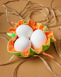 Three eggs in a colored bag Stock Images