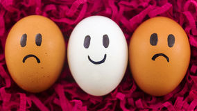 Three eggs with facial expressions Royalty Free Stock Photography