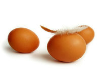 Three eggs with feather Royalty Free Stock Photo
