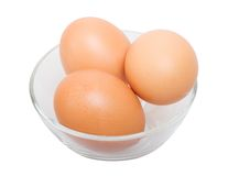 Three eggs in glass bowl Royalty Free Stock Images