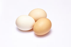 Three eggs isolated on white Stock Photos