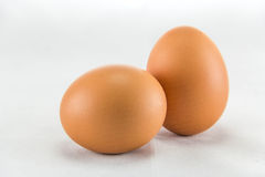 Three eggs are isolated on a white background. Stock Photo