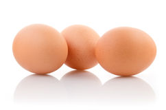 Three eggs isolated on white background Stock Photos