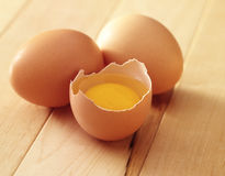 Three eggs one broken Royalty Free Stock Photography