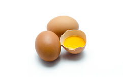 Three eggs, one broken egg Stock Photography