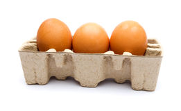 Three eggs in the package Stock Photos