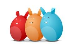 Three eggs - rabbits. Red, orange and blue eggs - rabbits, easter illustration on white Stock Photo