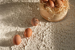 Three eggs at screens full of eggs on wood. En Royalty Free Stock Photography