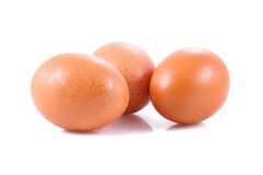 Three eggs on a table. Three eggs  over white background Royalty Free Stock Photos