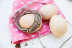 Three eggs on the table with a rose napkin Stock Photography