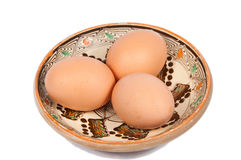 Three eggs on a traditional plate Royalty Free Stock Photography