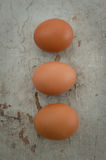 Three eggs on a wooden board Royalty Free Stock Images