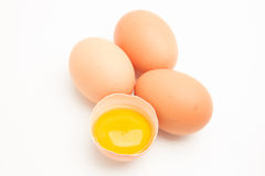 Three eggs with a yolk in half a shell Stock Image