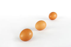 Three egs in a diagonal. Three eggs on a white background in diagonal stock photography