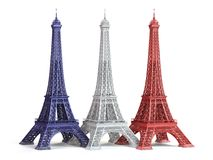 Three Eiffel Towerin colors of flag of France isolated on a whit Stock Photography