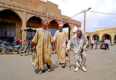 Three elderly Berber men go to souk of the city of Rissani in Morocco stock photos
