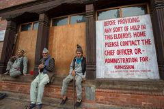 Three elderly men sitting in Nepal Royalty Free Stock Image