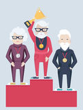 Three elderly people on a winners podium Royalty Free Stock Photo