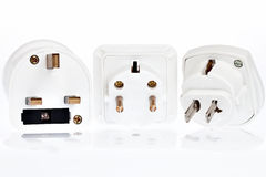 Three electric adaptors on a white background Stock Photo