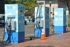 Three electric charging stations in Portland, Oregon. These are three charging stations for electric cars on Salmon Street in Portland, Oregon. They are operated stock photography