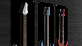 Three electric guitars hanging on a wall. Animation of three guitars hanging on the wall.  stock photos