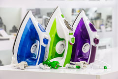 Three electric irons in retail store Royalty Free Stock Photo