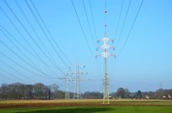 Three Electric towers on a field Stock Photography