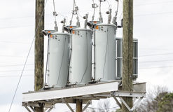 Three Electric Utility Transformers Stock Photography