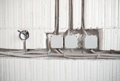 Three electrical junction boxes. With plastic conduit pipe connection royalty free stock images