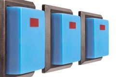 Three electrical switch. With blue buttons against white background Royalty Free Stock Photo