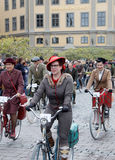 Three elegant cycling woman wearing old fashioned tweed clothes Royalty Free Stock Photo