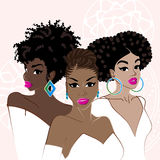 Three elegant dark-skinned women Stock Photo