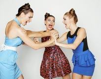 Three elegant fashion woman fighting on white Royalty Free Stock Image