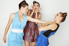 Three elegant fashion woman fighting on white Royalty Free Stock Photography