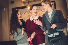 Three elegant young ladies ready for a party.  stock photo