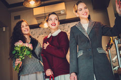Three elegant young ladies ready for a party.  stock image