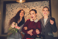 Three elegant young ladies ready for a party.  royalty free stock images